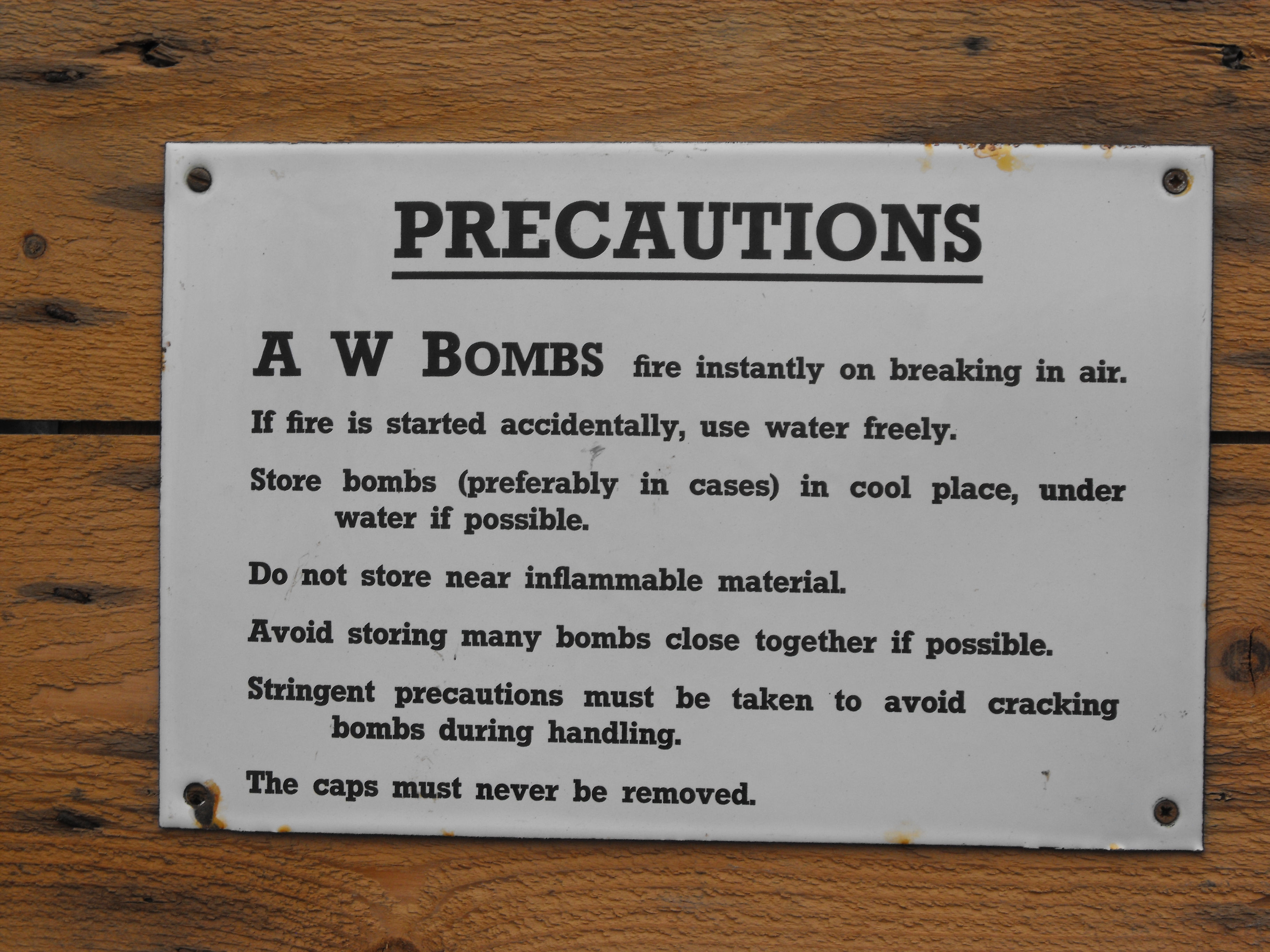 AW BOMB PRECAUTION SIGN
